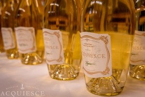 Acquiesce White Wines on a Table